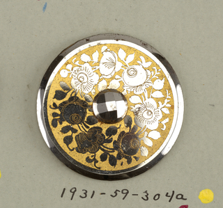 circular, flat buttons with bevelled edges; in the center, a facetted steel boss, surrounded by a ring of roses, in steel, against a yellow ground.  Component -a is on card 48 Component -e is on Cooper Union Exhibition card 5