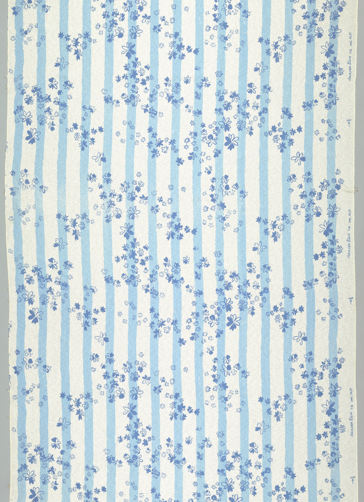 White ground printed with light blue stripes and small scattered designs of flower heads.