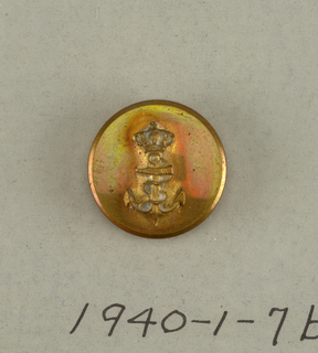 On card G. Circular flat button with brass anchor, fouled and crowned; on reverse: Lucas Saenz Madrid