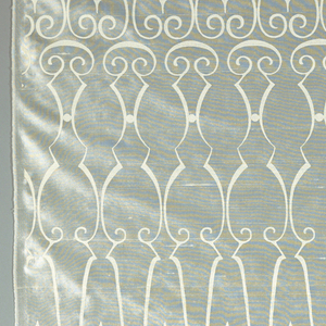 Length of white taffeta printed with white in a design showing stylized perpendicular curves.
