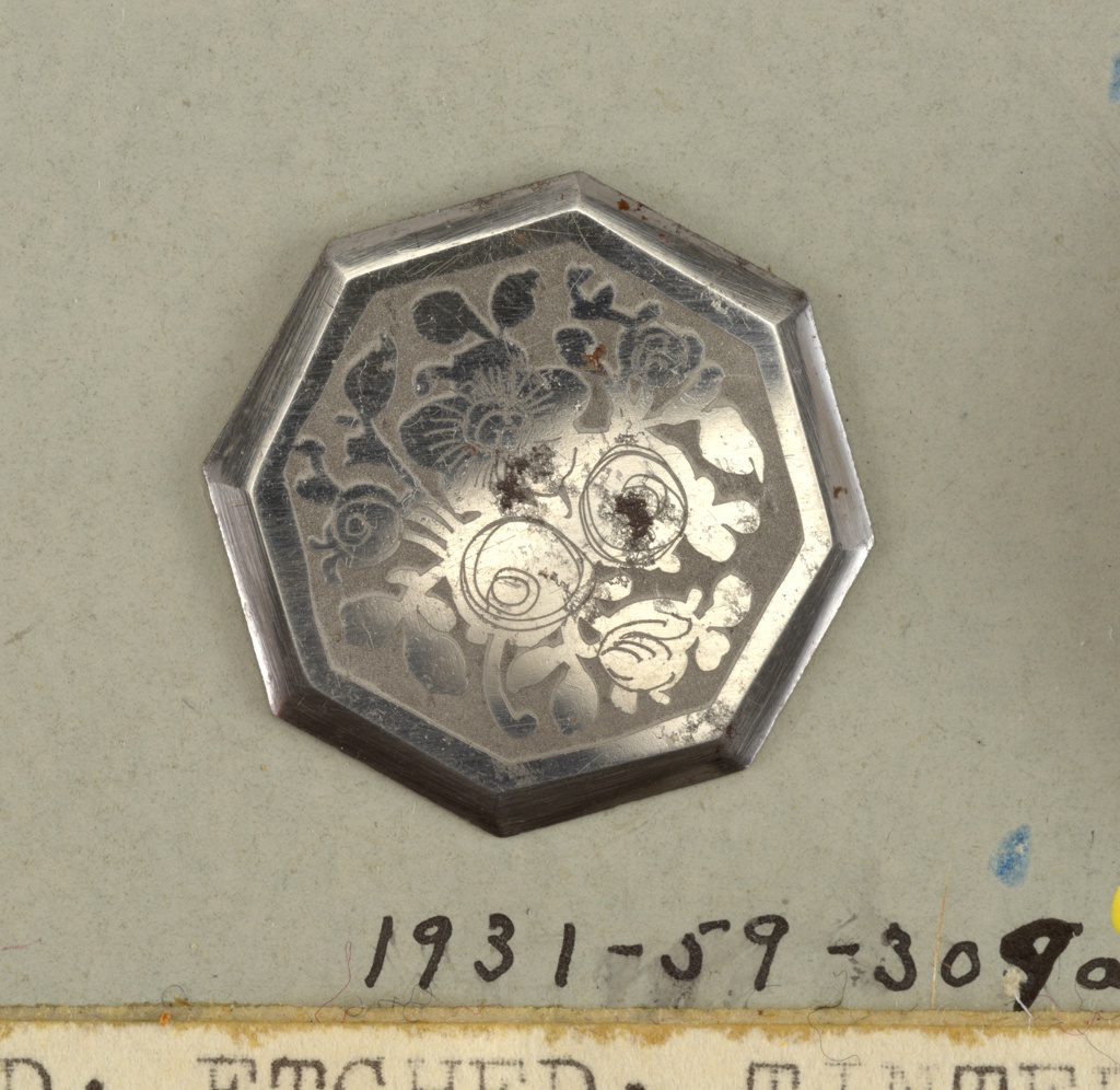eight-sided flat buttons ornamented with design of roses, in steel, on a dull ground.  On card 48