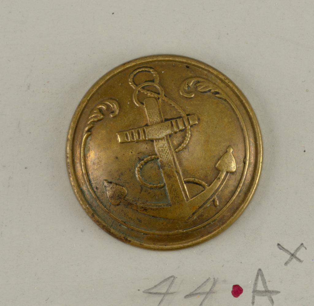 "Circular button showing design of anchor set within a curve which ends in acanthus leaves - on reverse, ""T. W & W Paris""; double shank - button used by Colonial Infantry.  On card H"