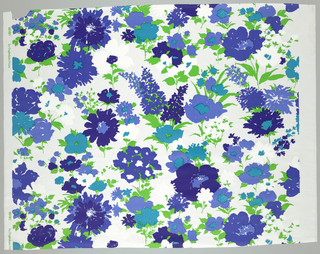 Allover floral pattern showing several types of flowers is printed in blue, turquoise, green and white on a white ground.