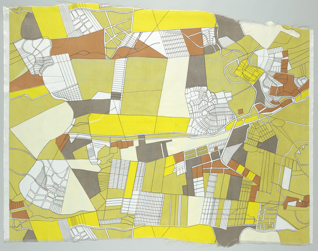Aerial view of a landscape in gray, brown, black, yellow and white.