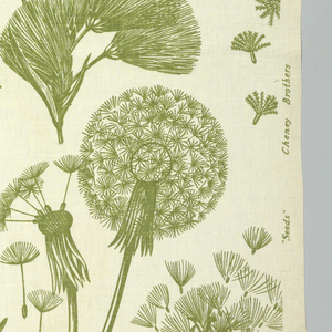 Large-scale design of flower heads gone to seed in soft olive green on a natural linen ground.