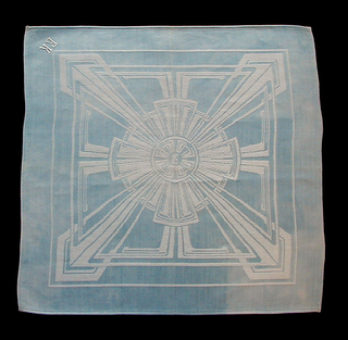 "Blue and white damask napkin with a geometric design incorporating circular and rectangular framing elements.  The monogram of Peter Behrens (PB) is woven into the center of the design. Initials ""E"" ""K"" embroidered in one corner. The four edges are machine hemmed."