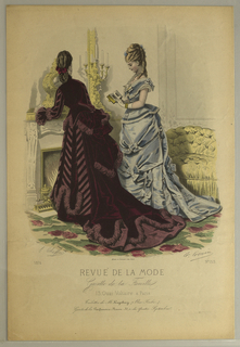 Fashion plate of two woman standing by a fireplace.  Woman with back turned shows the back of her deep purpple velvet long sleeved jacket and skirt.  A large bustle with draping fabric and train of dress.  There are panels of stripped fabirc on front of dress and along the sleeves of jacket.  Gathered fabric in a lighter shade of purple create trim along the bottom of skirt, bustle, and end of flared sleeves.  Woman in side profile reading a book wears a light blue sleeveless dress. Bodice is buttoned down the front with a dove atop a bow at the center of the neckline.  The bodice has a pleated white trim along the bottom of bodice, collar, and neckline.  There are bows on the shoulders of the bodice.  Throughout the skirt of the dress are draped and gathered fabric.  Some of the draped fabric creates bow along front and back of skirt.  She is also accessorized with white gloves, gold cuff and neclace with cross pendant.