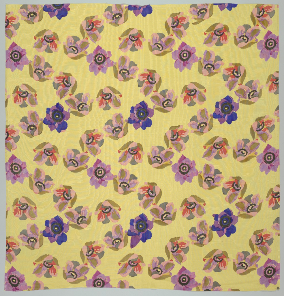 Yellow moiré with a design of flower blossoms running in diagonal lines and printed in brilliant polychrome.