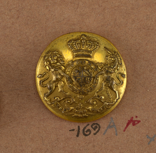 "Button showing coat of arms: heraldic devices surrounded by a band with ""Honi soit qui mal y pense"", lion and unicorn supporters, crown above and below, ribbon with ""Treu und fest."" Brass back and shank. On reverse, ""Firmin and Son 153 Strand, London.""  On card i80"
