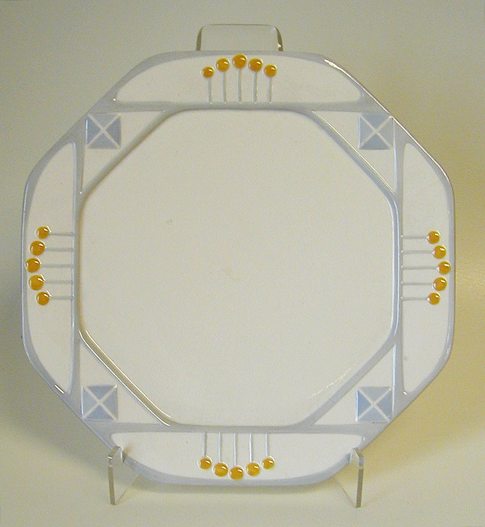 Octagon body with five yellow circles on four of the edges and blue diamonds on the other four edges.