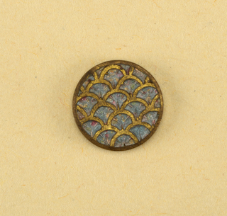 buttons showing ornament in design of scale pattern in brass outline filled in with enamel [?] of light blue with red flecks.  Component -f is on Cooper Union Exhibition card 8