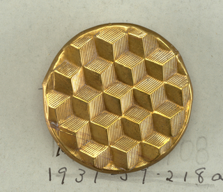 -a: flat circular button, cast in form of a series of blocks.