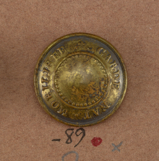 "Circular buttons, slightly convex with words ""Guarde Nat. Mobilisee"".  On card i80"
