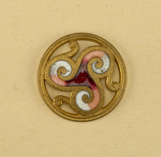circular button; central ornament composed of three scrolls filled with red, pink and white enamel; surrounded by rim; the intermediate sections being cut out.  Component -p is on Cooper Union Exhibition card 8