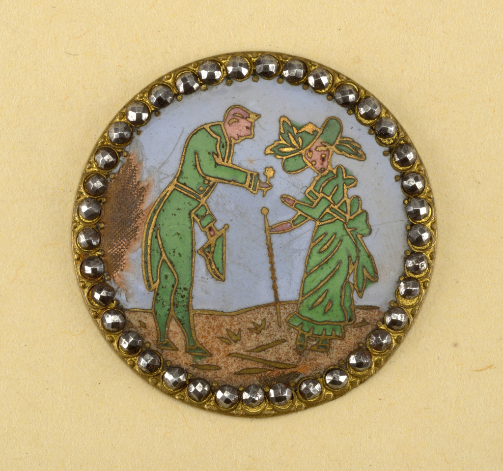 Enameled  button showing scene of gentleman handling flower to a lady surrounded by a ring of facetted steel knobs.  Component -a is on card 10 Component -b is on Cooper Union Exhibition card 8