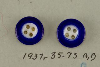 2 identical small blue buttons with white center and 4 holes for sewing -on card 6