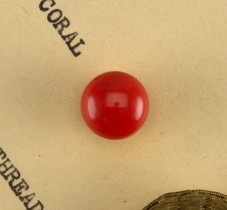 Component -a is on Cooper Union exhibition card 4. Four buttons made of a coral ball to which a gold shank has been added.