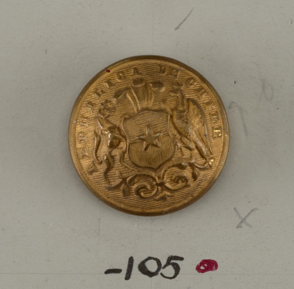 """Convex ornamented by shield showing star with horse and eagle supporters standing on scroll; plumes at top of shield. """"Republica de Chile"""" around edge of button. Brass back and shank. On reverse, """"Extra Fein"""".  On card D"""