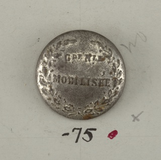 "Slightly convex button with ""Grenle Mobilisee"" placed within crossed laurel sprays.