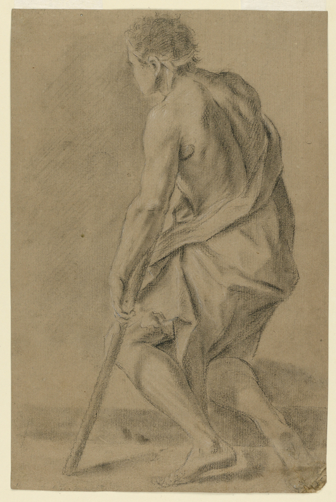 Vertical composition of a half-naked man with a crutch, shown from the left back, kneeling on his right knee. Reverse: a part of a black crayon study showing a part of an arm.