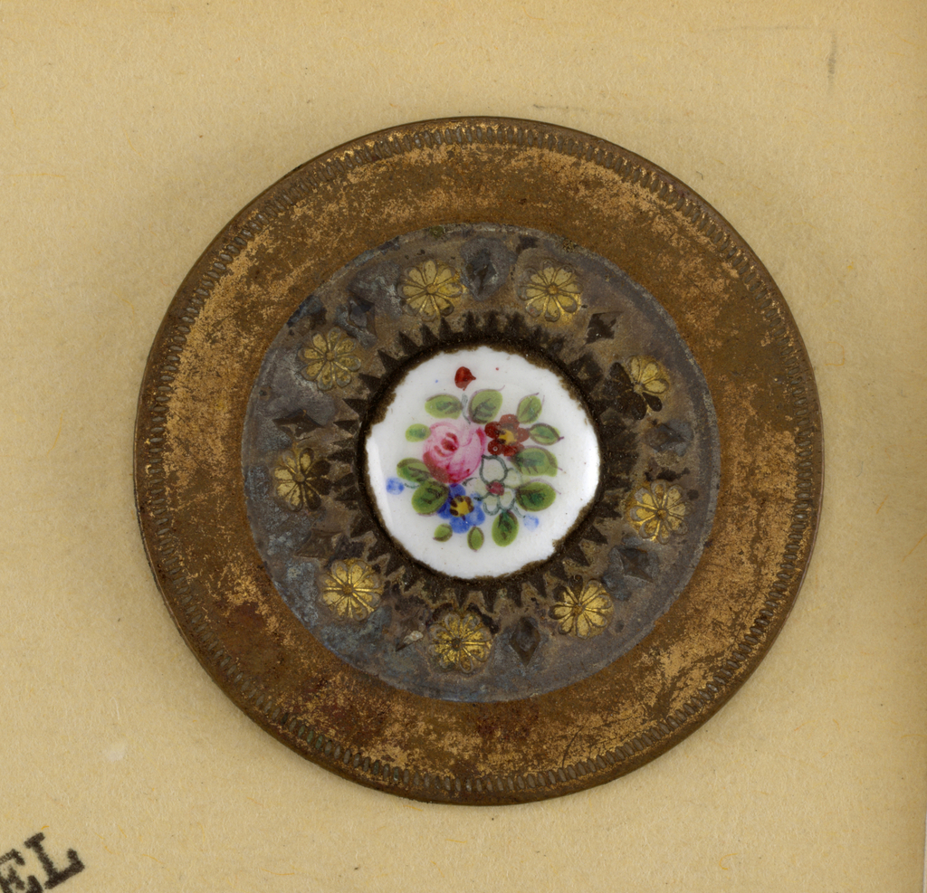 Component -c is on card 4 Circular buttons of copper with nickel band ornamented with eight-petalled flowers and lozenges in brass; floral spray painted in color as central ornament. Floral spray on -d slightly different from -a/c.