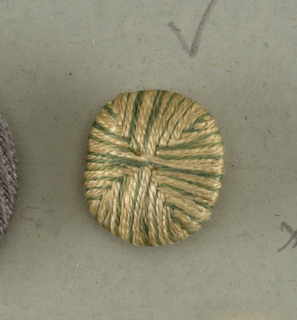 Two buttons: pale pink and light green silk thread wound or sewed on bone or wood button frame, so as to divide face of button into four quarters, each quarter composed of straight lines of the two colours.  Component -a is on card A Component -e is on Cooper Union Exhibition card 3