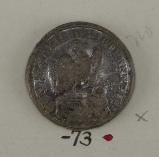 """Slightly convex button showing cock (facing right) with claw on ball. Around outside """"Gendarmerie Departementale"""" and below cock, """"Surete Public"""". back and shank of brass. On reverse, """"Gin petit and du perier Lr"""".  On card D"""
