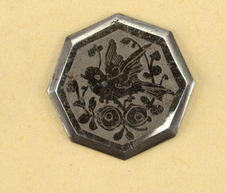 Eight-sided flat buttons ornamented with design of a bird and a flowering spray in steel, on a dull ground. Component -c is on Cooper Union Exhibition card 8