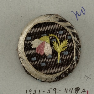 four buttons made of wooden molds covered with silk and embroidery a: fancy silk with single bell-shaped flower - b/: floral spray on dark gray background fabric - c/: floral spray on yellow background fabric - d/: single flower on ribbed silk.  Components -a,-c are on card A