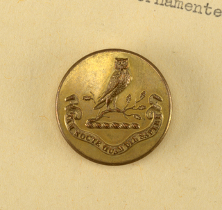 Component -m is on Cooper Union Exhibition card 5 Circular brass buttons with Hewitt Crest.