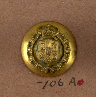 "A,B,C) Convex button with ornament showing a shield with coat-of-arms surrounded by a chain and surmounted by a crown. Tin back. Brass shank. On reverse, ""Superfin, Paris"".  Components -a,-b are on card i80 Component -c is on card C"