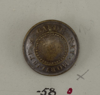 "dotted circle in center, words ""Garde Nat. Mobiliste"". Star beneath. White metal back.