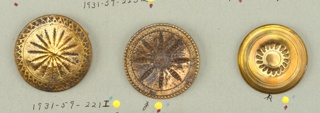 flat circular buttons ornamented with engraving and gouging in various patterns.  Components -a/-l, -n/-p are on card 47