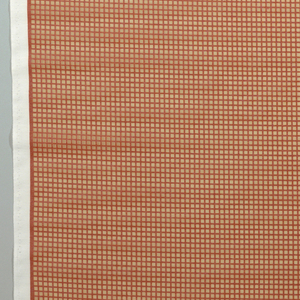 Design with orange grid on one half, grey grid on the other half. Area within small squares is sheer