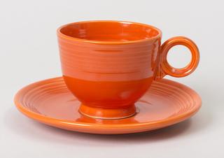 Red tea cup saucer.