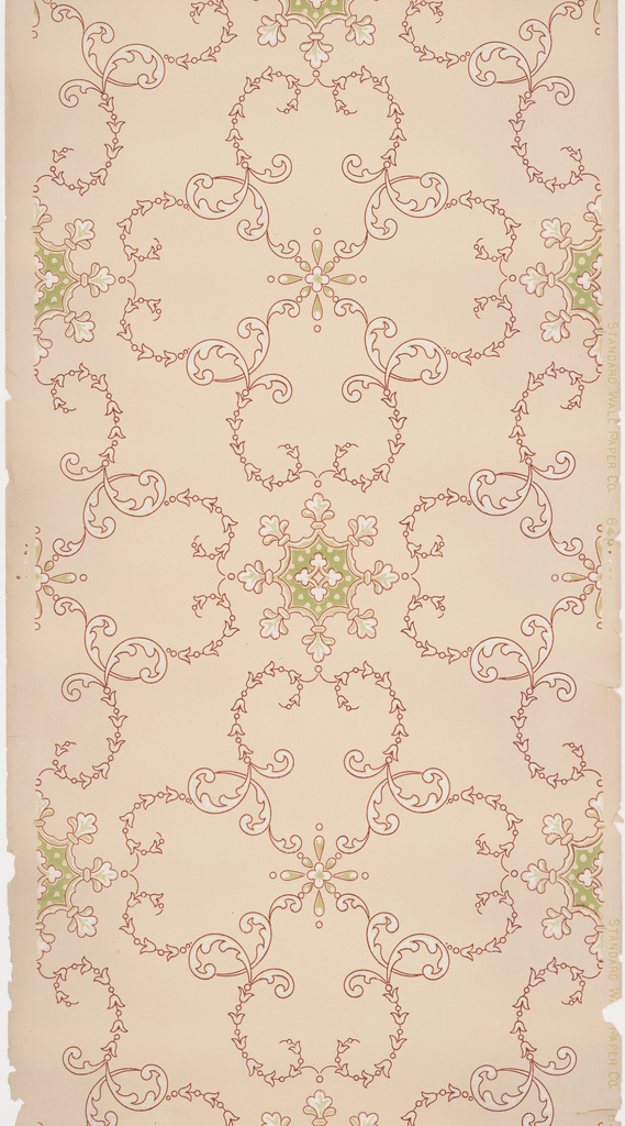 Acanthus scrolls and bellflowers form large quatrefoils, star or snowflake-like motif at intersection. Printed in red, green, and white mica on light tan ground.