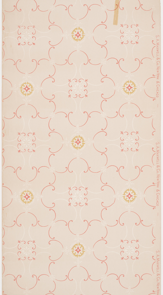 Large and small C scrolls are joined together to form a loose trellis pattern. Printed in red and white mica on light tan ground.