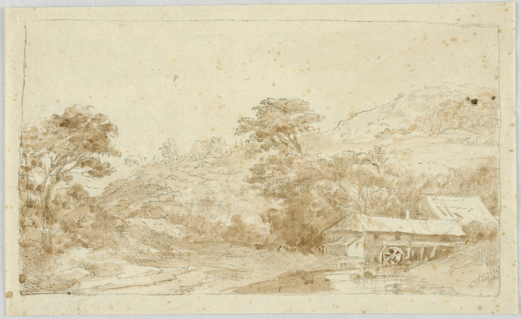 A watermill surrounded by trees with a hill rising in the background.