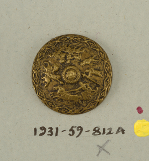 button ornamented in design of a procession of men on foot, on horseback and in a chariot.  on card 42