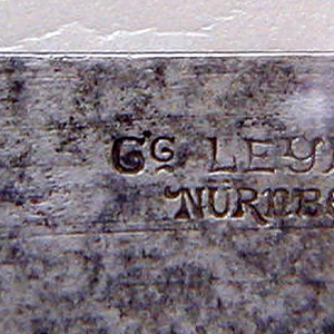 Long scalpel-shaped blade; handle slightly pistol-shaped, engraved with linear borders and oval cartouches at top and bottom, lower one with leafy motif.  JO monogram in square at lower end of handle.