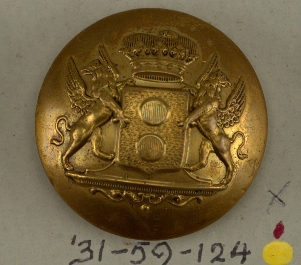 Convex button with shield.  On card 45