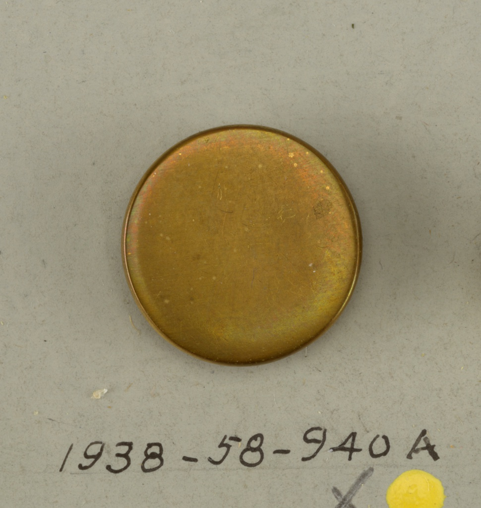 2 circular brass buttons; flat ; plain - for other buttons from the same set see: 1938-58-940-b/i,  which are deaccessioned.