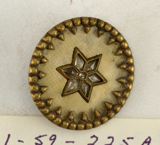 Flat circular button with shanks, varying.  On card 31