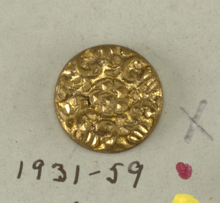 button with cast decoration in flower pattern.  On card 41