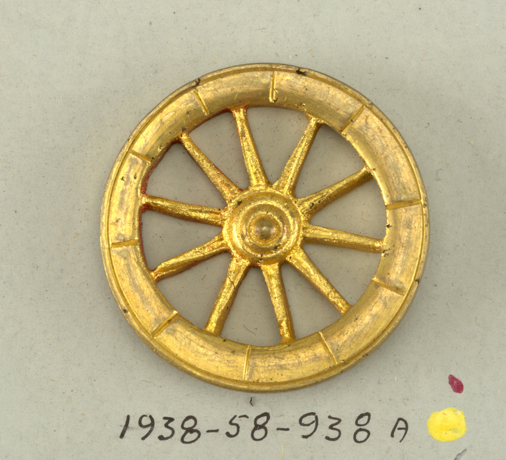 brass button in form of wheel - see 1938-58-938-b/h for others of this set now deaccessioned.  on card 42