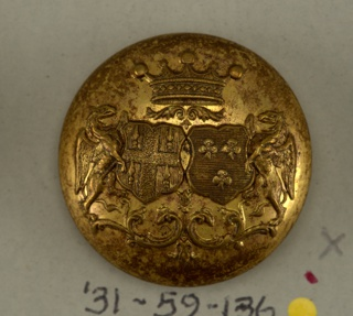 "Circular, convex button showing coat of arms of two shields with heraldic devices, winged animal supporters, leaf mantling; surmounted by a crown. On reverse ""Bessaignet Gravr. 15 Palais Royal."" Brass Shank.