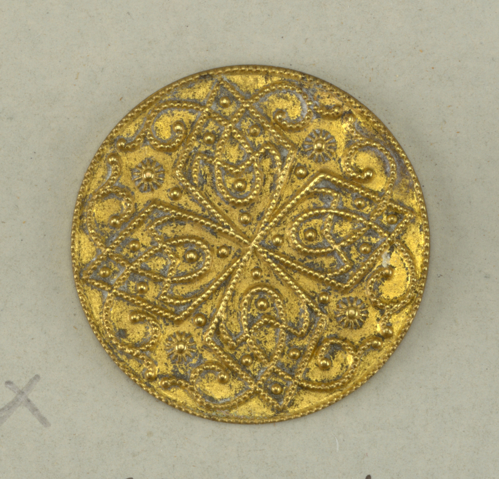flat circular buttons with cast ornament in design of lozenges with interlacing scrolls.
