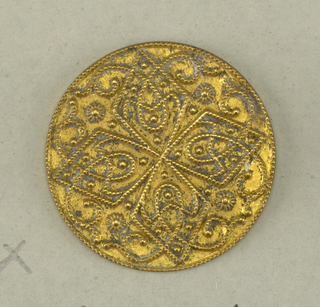 flat circular buttons with cast ornament in design of lozenges with interlacing scrolls.  On card 41
