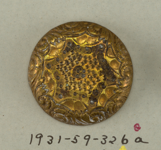 Domed, circular buttons with ornament of leaves on the edge and hexagon with in-curving sides in center.  On card 41
