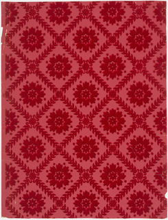 Diagonal lattice of formalized leaves centered with stylized floral medallions. Red flock on red embossed ground.